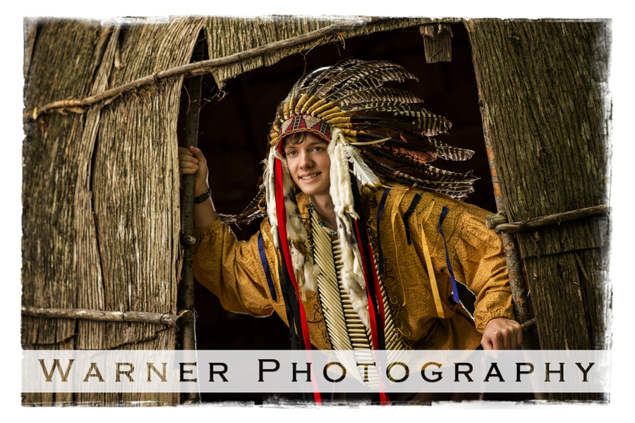 Senior portrait of Noah at Chippewa Nature Center in his ceremonial Spirit of Akela headdress and outfit