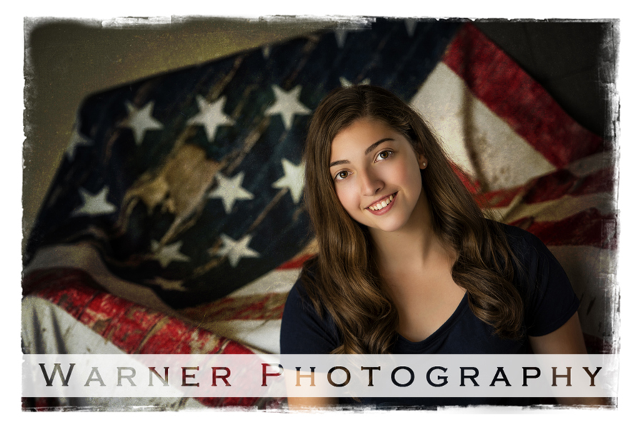 Midland High School Senior portrait of Caroline, at the Warner Photography Studio with an american flag background