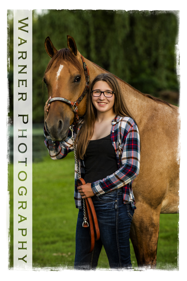 A senior portrait of Bay City Western senior Madison at the Horse Stable with her horse