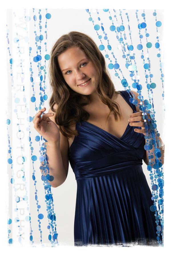 A senior portrait at the Warner Photography Studio of Midland High School Senior Taryn with blue beads