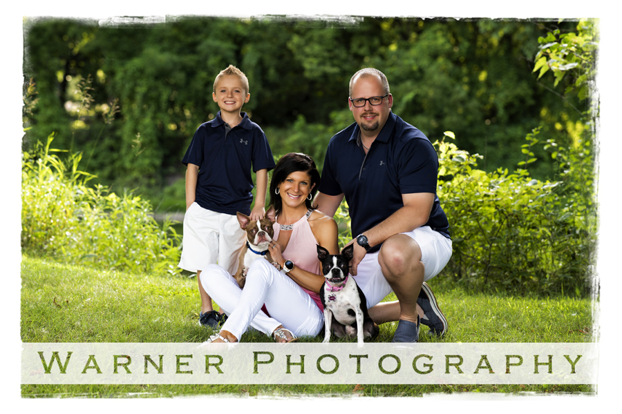 Ulery Family Portrait at Emerson Park in Midland Michigan with their son and their boston terriers by Warner Photography in Midland Michigan