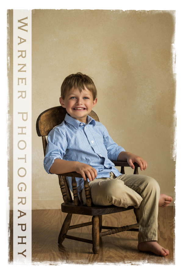 A studio portrait of Birthday Club member Daniel for his 4th birthday at the Warner Photography Studio in a rocking chair