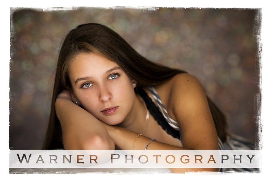 A studio portrait of Midland High School senior Jenna at the Warner Photography Studio in warm tones