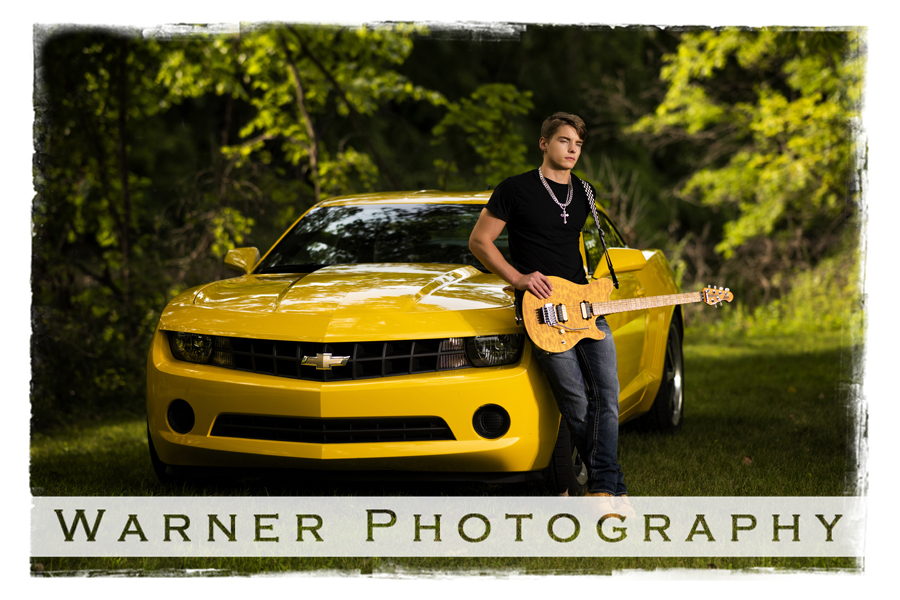 Senior portriat of Dow High School Senior Justin at the Bradley House in Midland, Michigan with his yellow car and his guitar