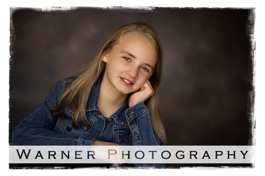A studio portrait of Kaitlin for her Back to School session with a traditional background