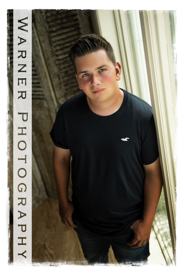 A studio senior portrait of Heritage High School senior Kevan at the Warner Photography studio