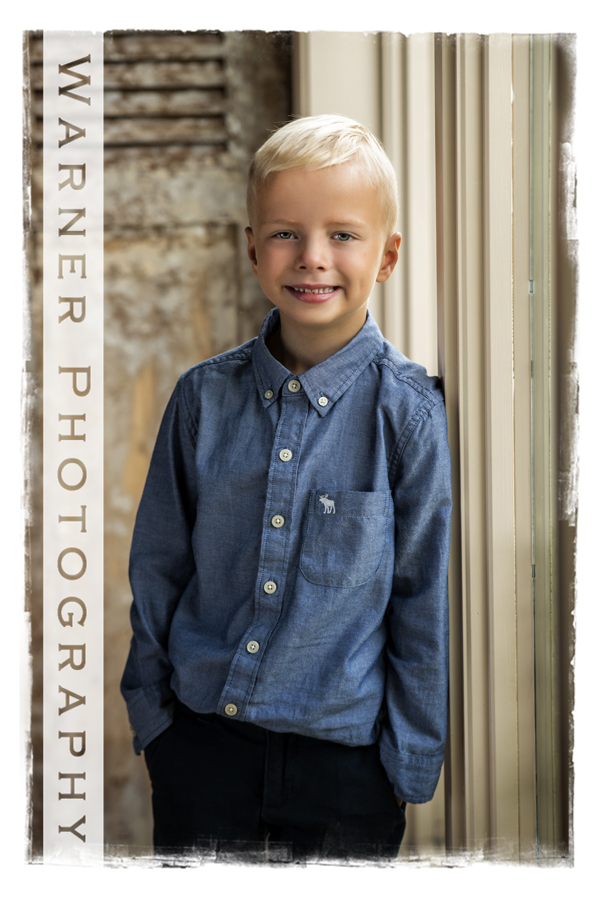 A traditional Back to School portrait of Quintin by the window at the Warner Photography Studio