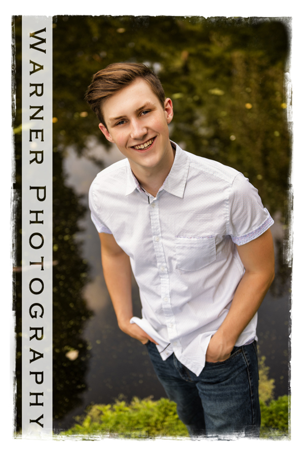 Outdoor portrait of Bullock Creek High School senior Ryan at Dow Gardens by the water