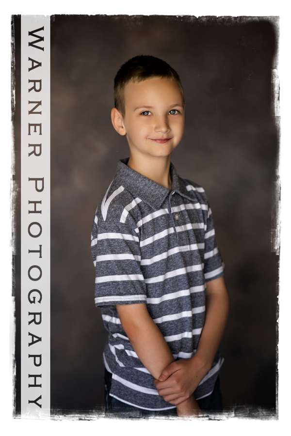 A studio portrait of Sam for his Back to School Session with a traditional background