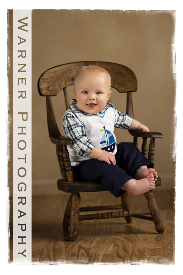 Year of Memories portrait of Amadeus for his six month pictures at the warner Photography studio sitting in a rocking chair