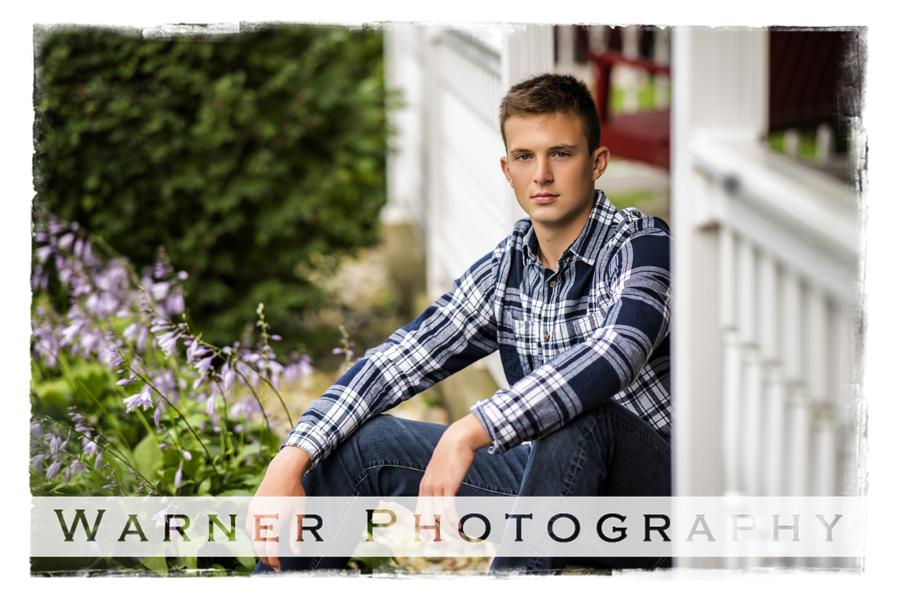 Senior portrait of Meridian High School senior Gabe at his family farm on a white porch