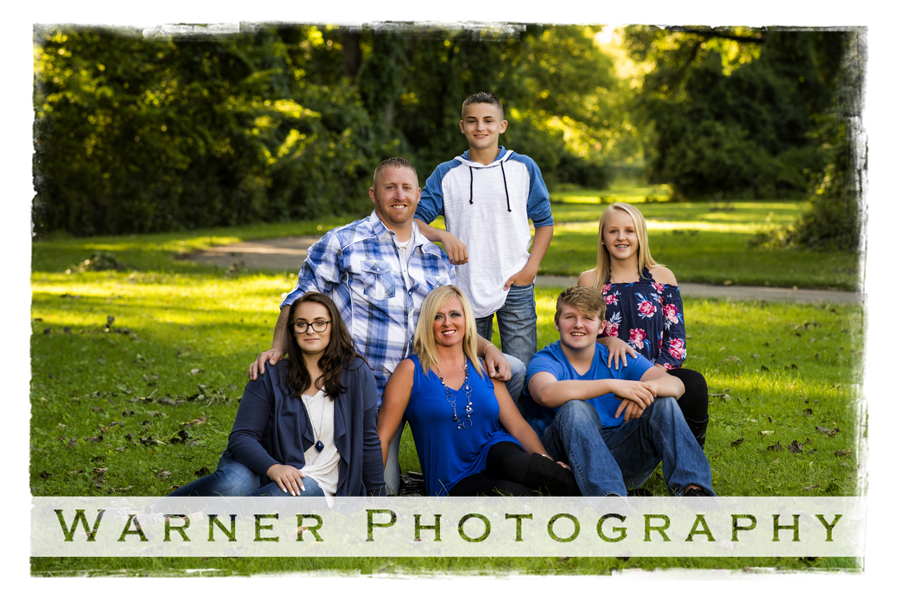 A family portrait of the Rytlewski family at Bay City State Park surrounded by trees