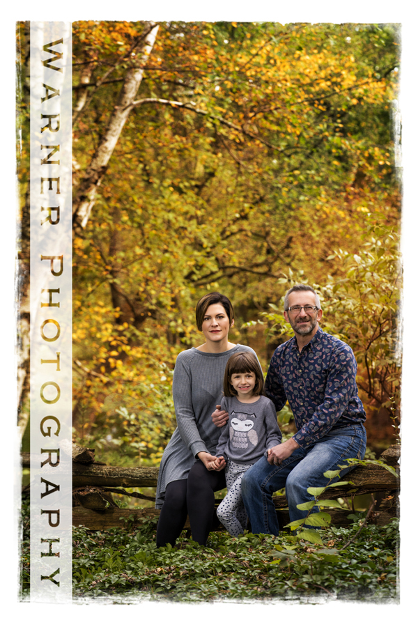 An outdoor Fall Family portriat of the Dill Family at Dow Gardens with the changing fall leaves