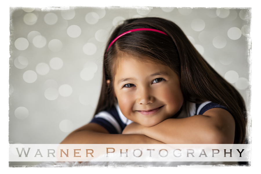 A traditional studio portrait of Georgia for her Back to School Session