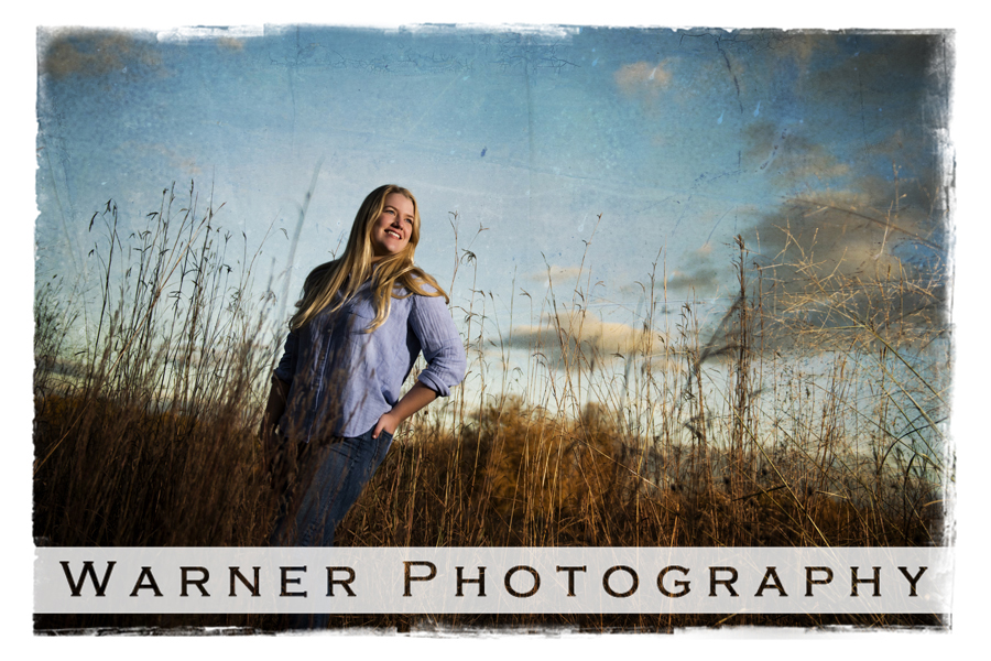 Outdoor senior portrait of Midland High School senior Maureen at Chippewa Nature Center with tall grass and blue fall sky