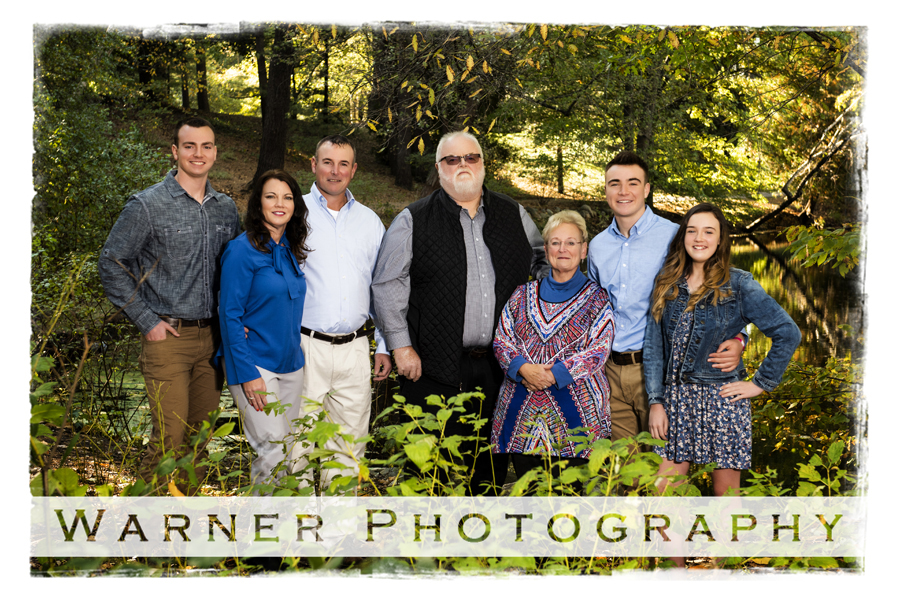 Fall Family Portrait of the Parsons family at Dow Gardens with trees and leaves
