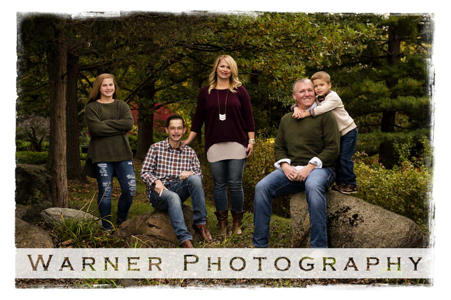 An outdoor family portrait of the Puls Family at Dow Gardens for the fall colors