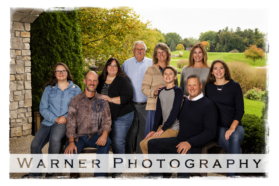 An outdoor family portrait of the Tanis Family at the Midland Country Club on a fall morning