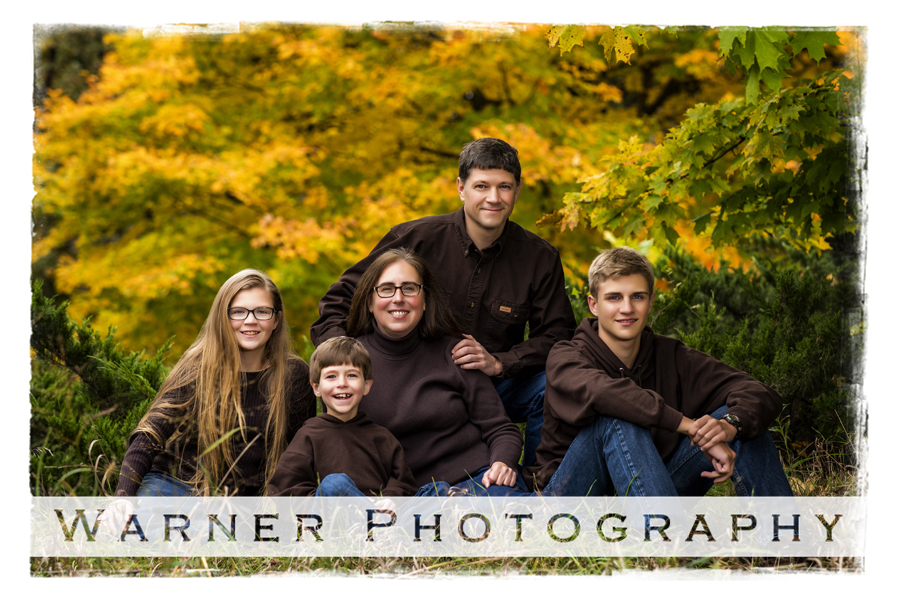 Fall family portrait of the Telgenhoff family at Dow Gardens with the yellow fall leaves in Midland Michigan