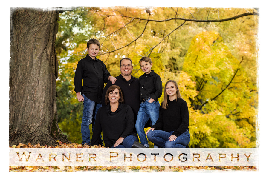 Outdoor family portrait of the Dominowski family at Dow Gardens
