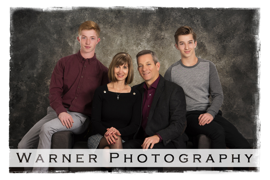 A classic studio family portrait of the Murphy family at the Warner Photography Studio