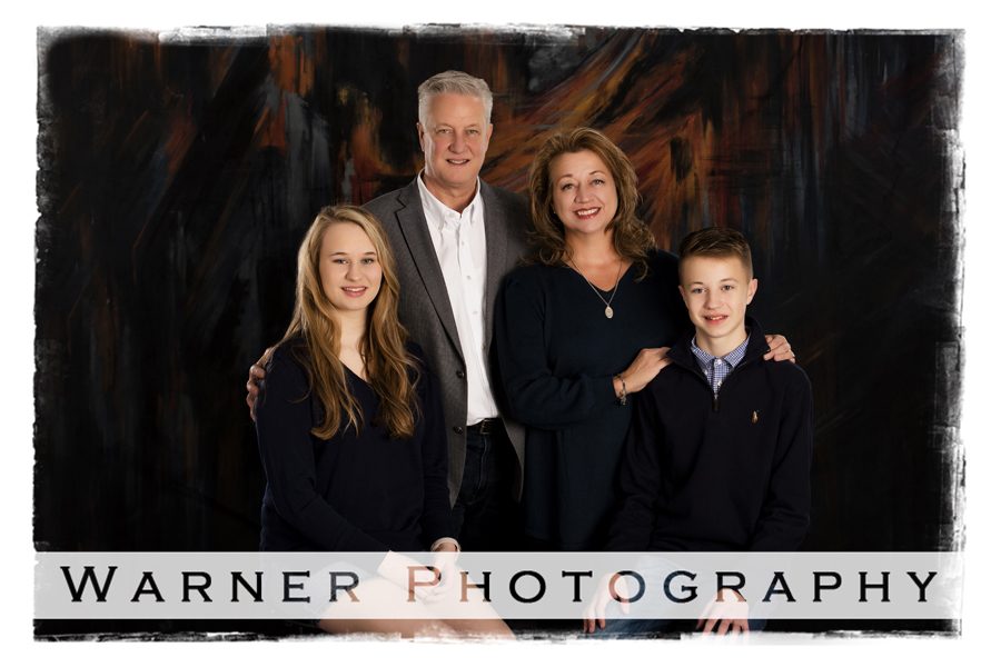 A traditional family portrait of the Davis family at the Warner Photography Studio