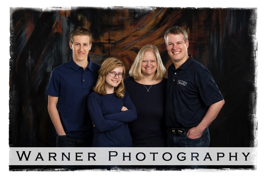 Classic family portrait of the Johnson family at the Warner Photography studio