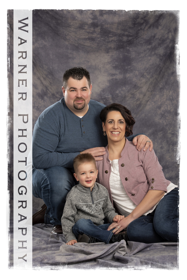 A classic family portrait of the Swanson family at the Warner Photography Studio