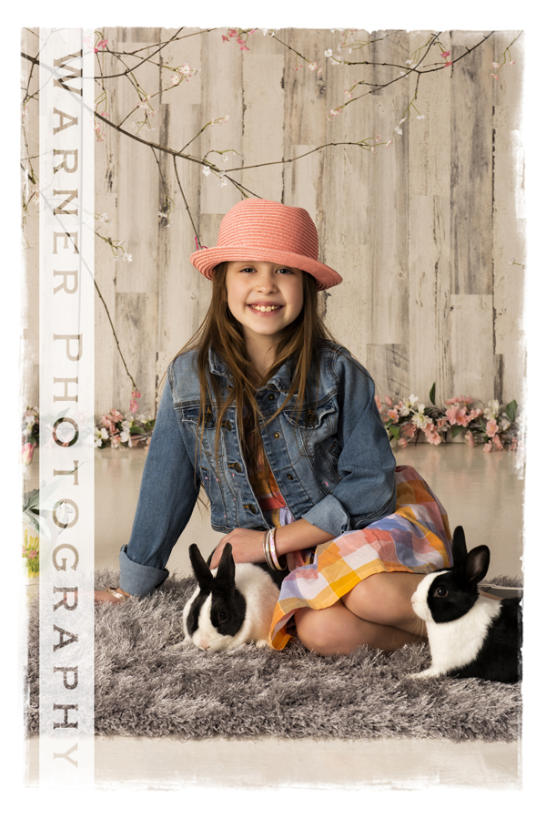Holiday Easter portrait of Zoey with bunnies and spring flowers at the Warner Photography Studio