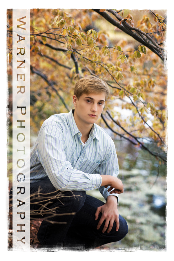 Outdoor senior portrait of Dow High School senior Gage at Dow Gardens stream and trees