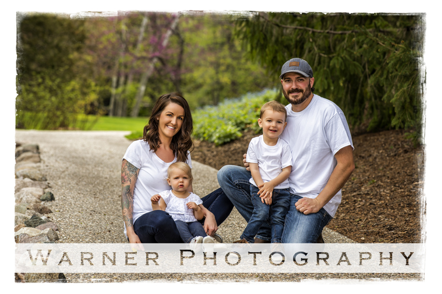 Outdoor Dow Gardens family portrait gallagher family jeans tshirts sidwalk trees flowers