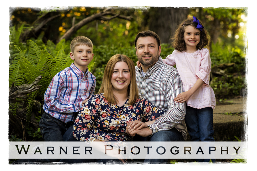 Outdoor family portrait of the Hafeli family at Dow Gardens with trees and flowers