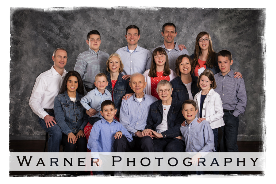 Monroe family portrait at the studio with a grey background