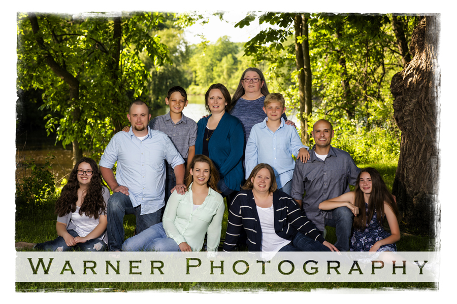 Outdoor family portrait of the Mecomber family at chippewa Nature Center with green trees