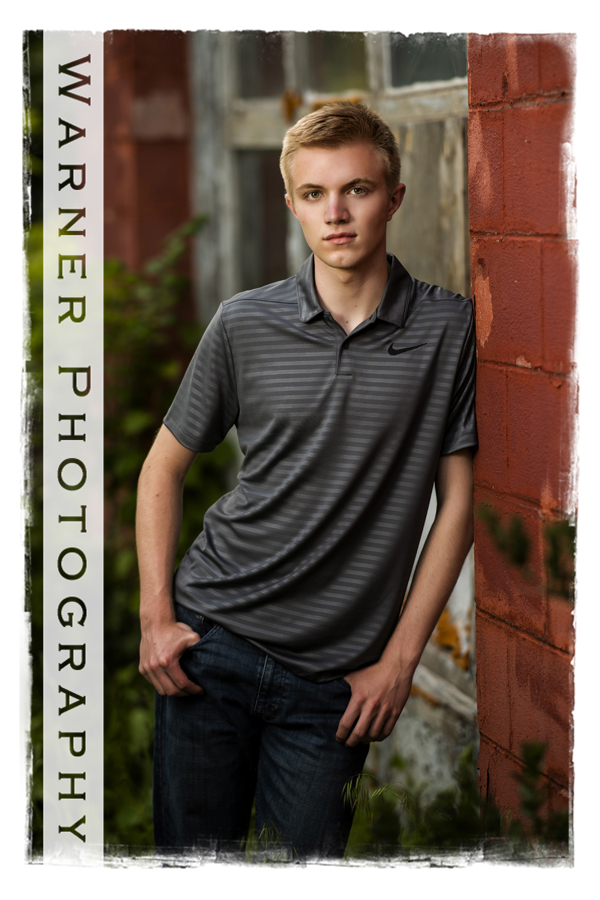 Downtown Bay City senior portrait of Dow High senior Nathan outdoor brick wall