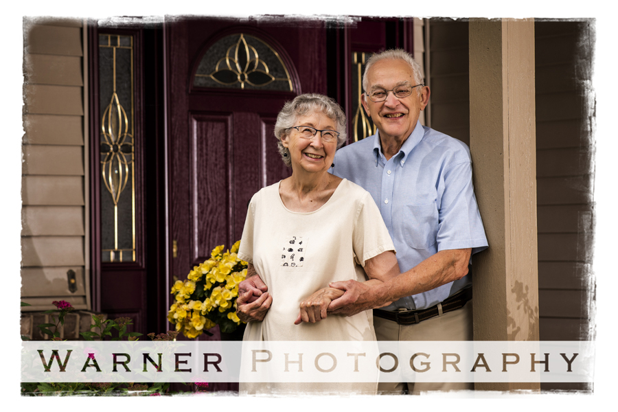 outdoor portrait of Betty and Tom at their home by their front door