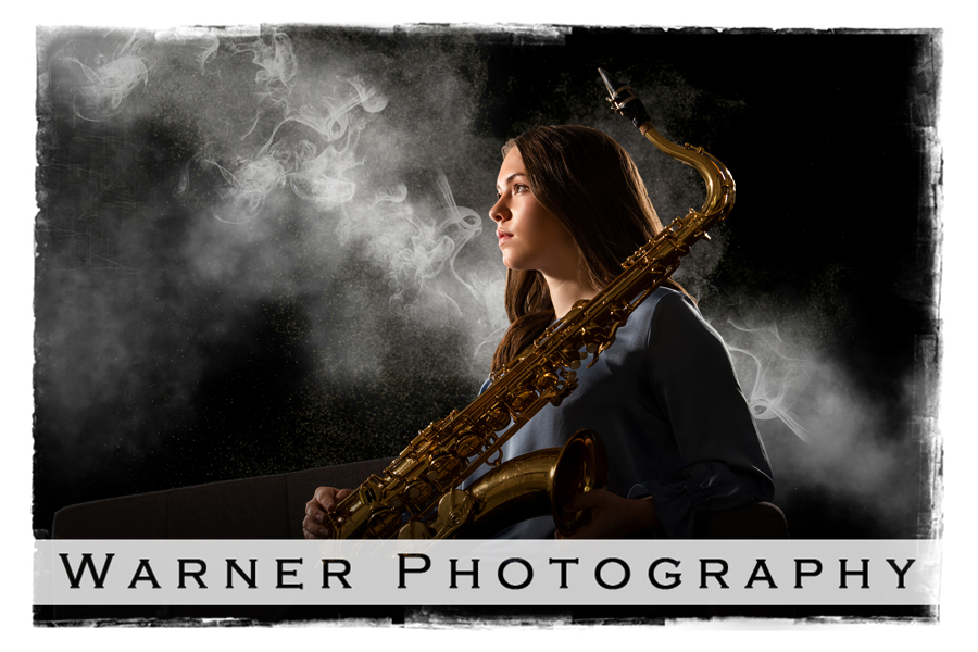 Studio portrait of Midland High School senior Hannah with her saxaphone and smoke