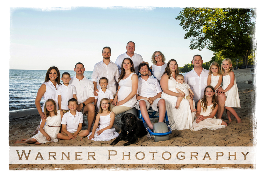 Outdoor portrait of the Murtha family on the beach in Oscoda