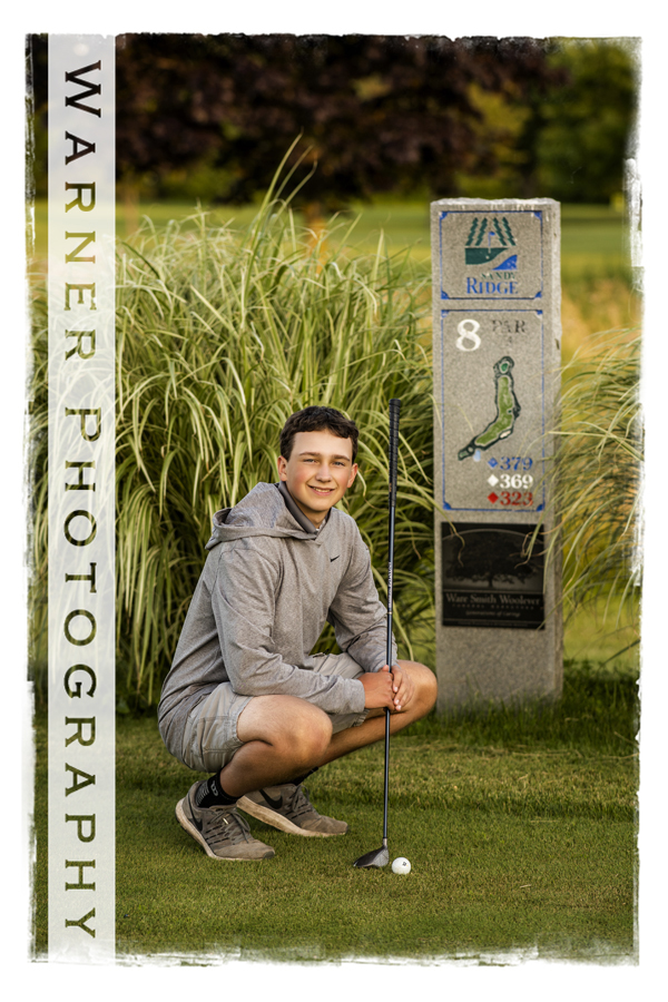 Outdoor portrait of Midland High School senior Shane at Sandy Ridge Golf Course with his clubs