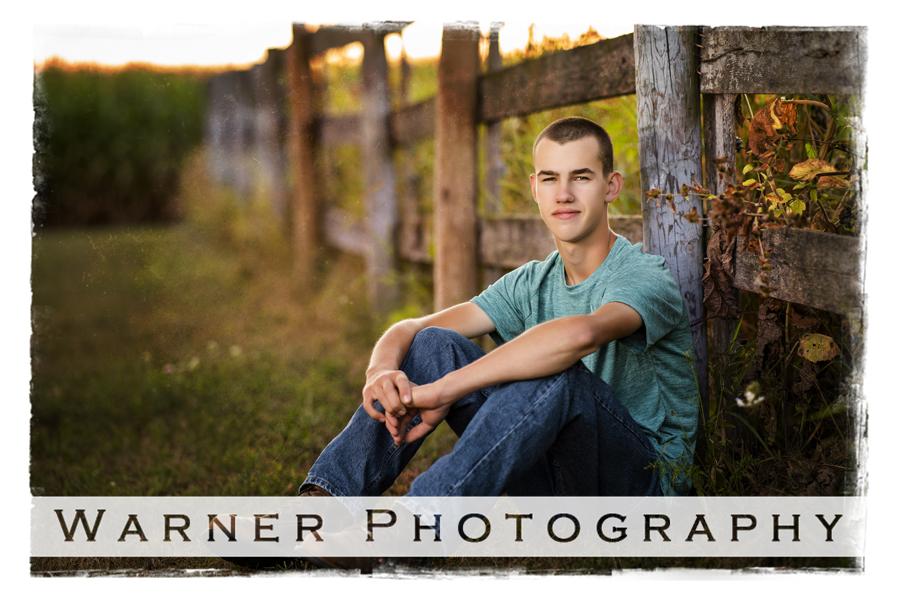 Outdoor senior portrait of Coleman High School senior Benjamin with a wooden fence