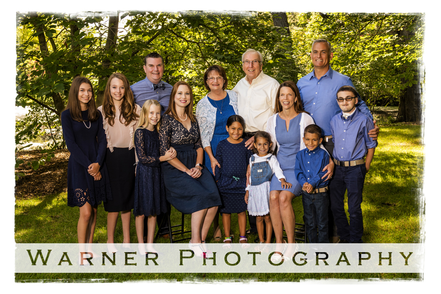Outdoor family portrait of the Buckler family at Dow Gardens