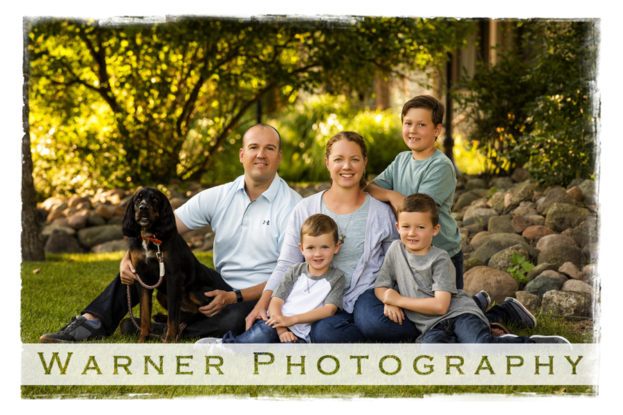 Outdoor family portrait of the Cousineau family at the Bradley House