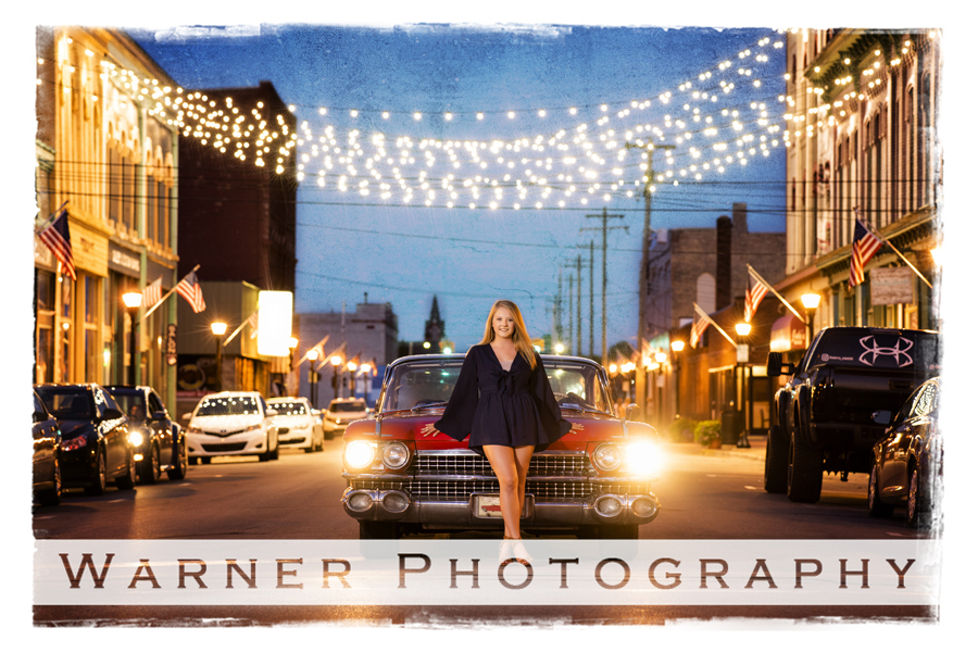 Outdoor Senior portriat of Haleigh in Downtown Bay City bridge of lights with her red classic car