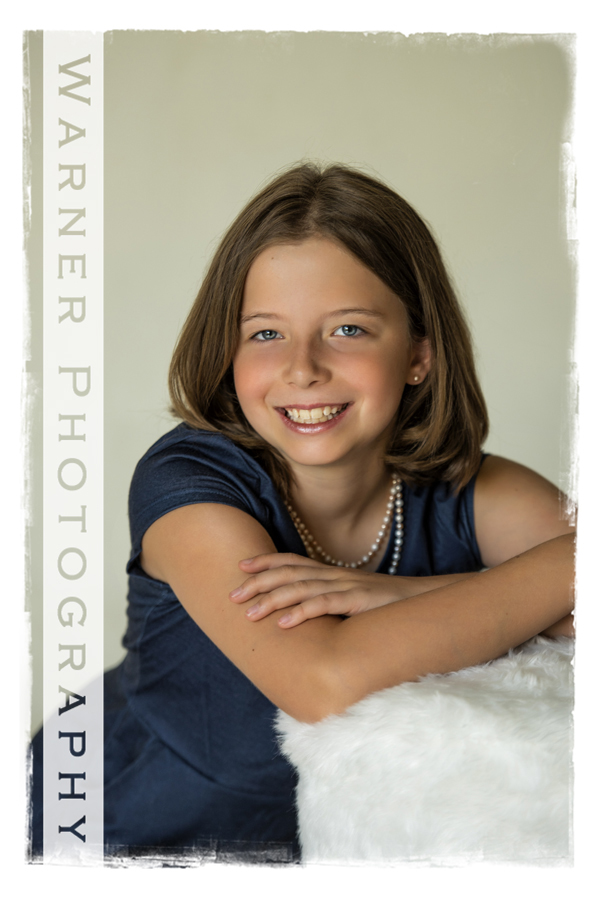 Studio portrait of Jocelyn for her Back to School session with a white stool