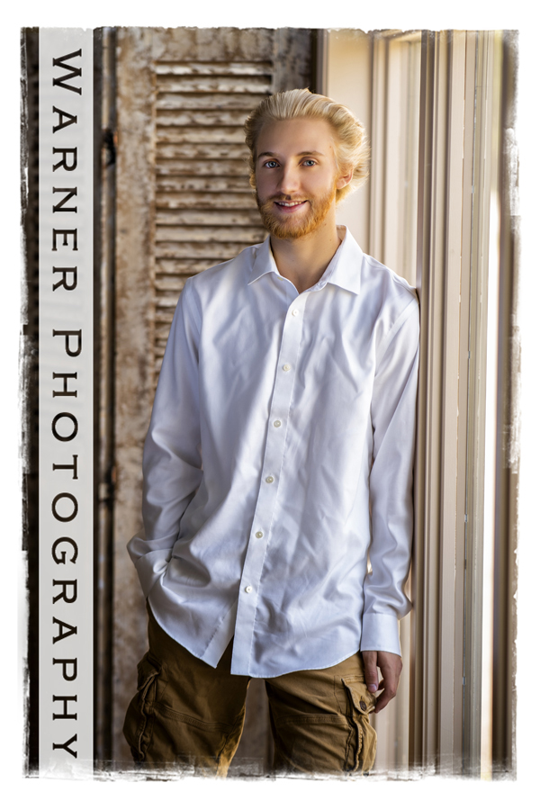A studio portrait of Dow High School senior Nathan by the window in the studio
