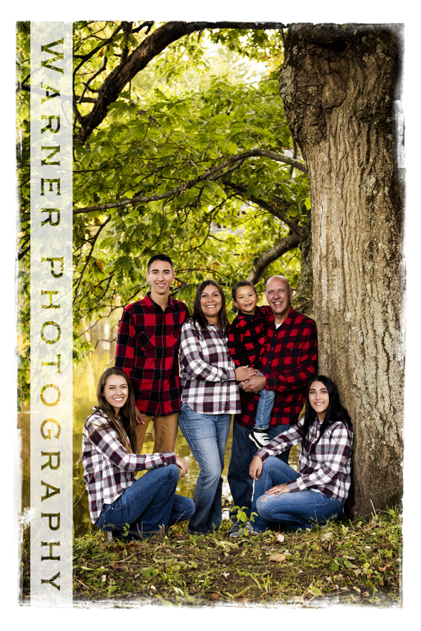 outdoor family portrait of the Davis family at Chippewa nature center plaid and fall trees