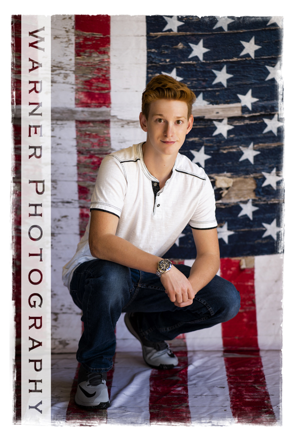 studio portrait of Dow High School senior Dylan with an american flag background