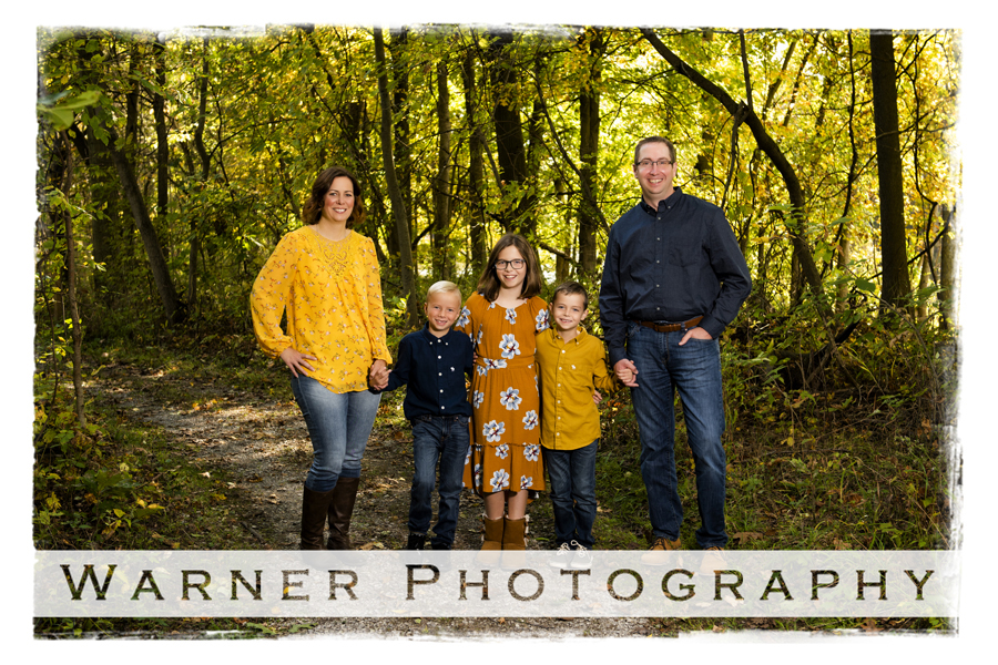 outdoor portrait of the Rivard family at Chippewa Nature Center with the woods and fall colors