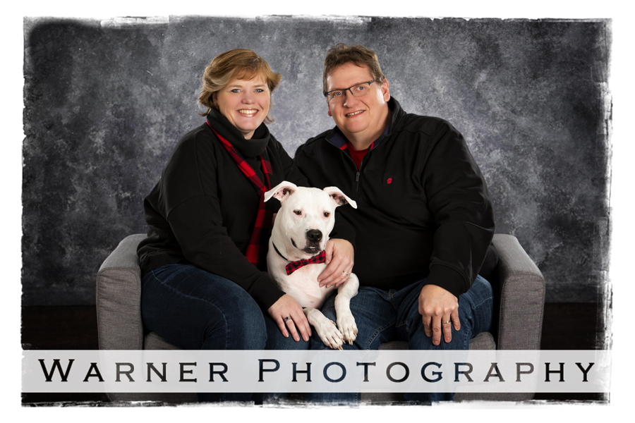 A studio portrait of the Howson family and their dog Diesel