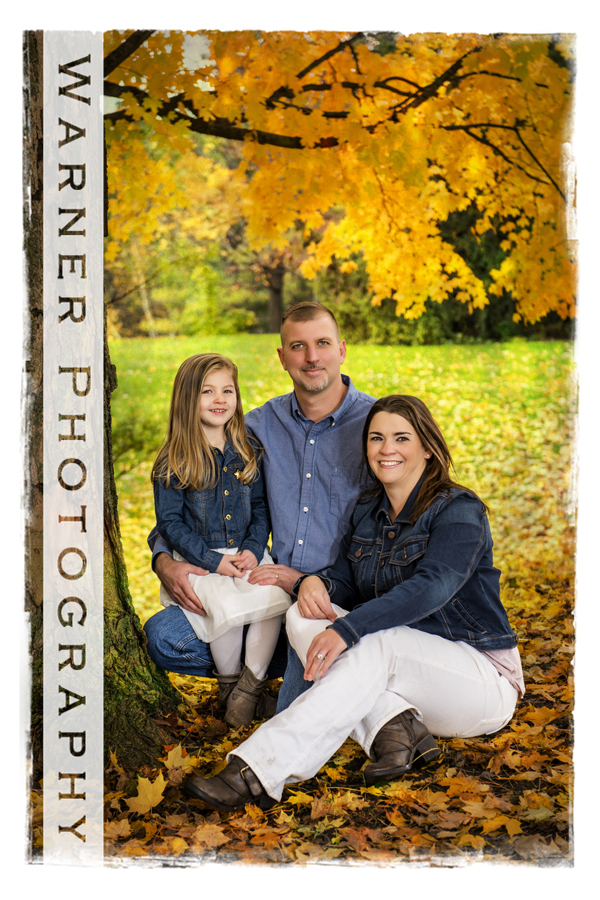 outdoor family portrait of the Letzkus family at Dow Gardens with yellow fall leaves